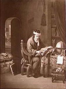 Een lezende man in zijn studeerkamer