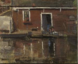 House façade on the water with woman washing