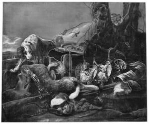 Een spaniël bij jachtgereedschap en een jachtbuit van een haas en patrijzen