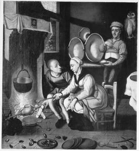 Keukeninterieur met een man en een vrouw bij het spit