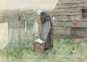 Vrouw bij een waslijn