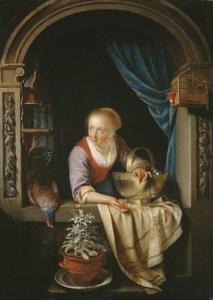 Jonge vrouw in een venster met een koperen schaal met appels en een dode fazant