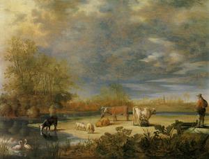 Landschap met koeien en schapen op een weide aan hetwater