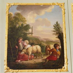 Spelende kindertjes met twee schapen