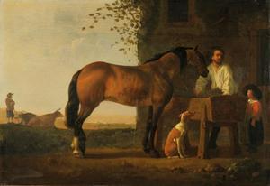 Bruin paard bij een voederbak