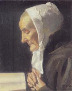 Oude vrouw in gebed