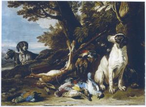 Honden bij jachtbuit in een landschap