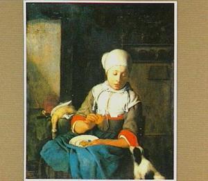 Jonge vrouw die hond voert