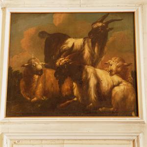 Een landschap met twee bokken en twee schapen
