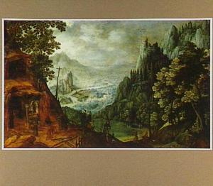 Monniken in een grot met uitzicht op een weids berglandschap