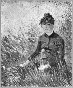 Een vrouw gezeten in het gras