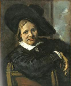 Portret van een zittende man met slappe hoed