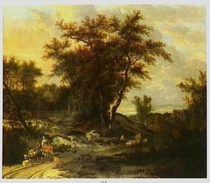 Boslandschap met herders en vee op weg