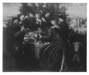 Musicerend gezelschap rond een tafel in een tuin