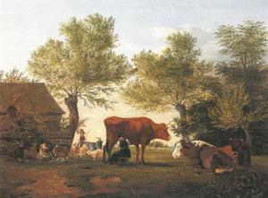 Melkende boerin met koeien op een boerenerf