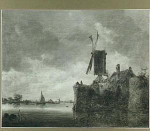 Riviergezicht met een molen op een stadsmuur