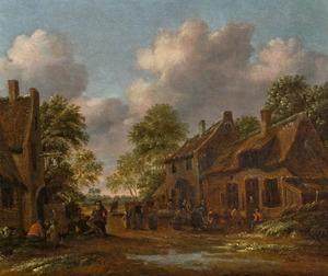 Dorpsstraat met een herberg