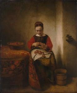 Jonge vrouw appels schillend