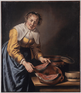 Een keukenmeid bereidt zalm