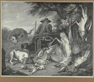 Jager met drie honden bij een jachtbuit van gevogelte