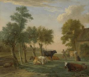 Koeien in de weide voor een boerderij