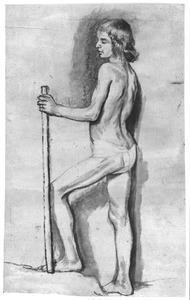 Staande naakte jongen met een stok