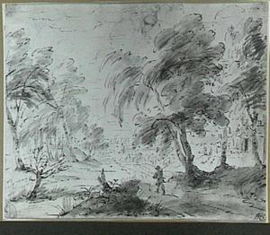 Figuur in een boslandschap