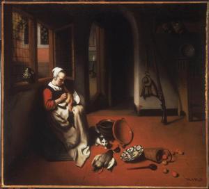 Keukenscène met een jonge vrouw die een eend plukt