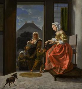 Jonge vrouw die een aalmoes geeft aan bedelaars bij de deur