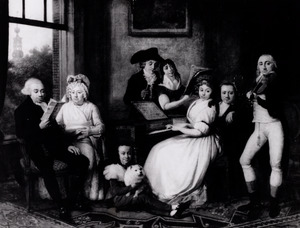 Portret van een musicerende familie in een interieur