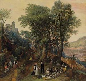 Boslandschap met een picknick aan de voet van een burcht