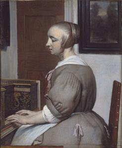 Jonge vrouw aan het virginaal