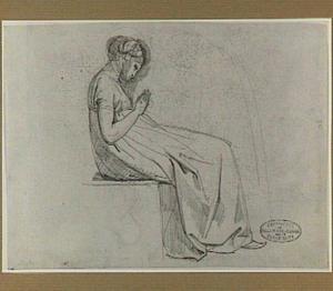 Zittende, biddende vrouw