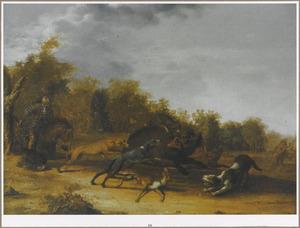 Een jager en zijn honden op zwijnenjacht