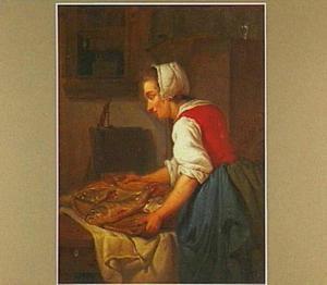 Jonge vrouw met een schaal met vis