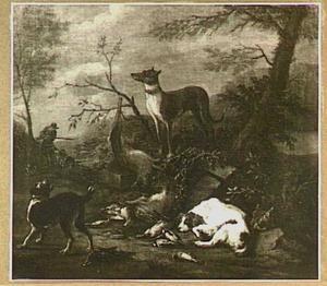 Honden bewaken jachtbuit in een landschap; links in de achtergrond een jager