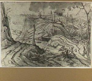 Heuvellandschap met landweg, molen en galg