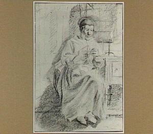 Zittende handwerkende vrouw