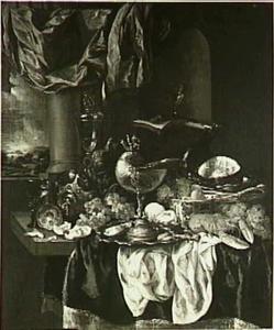 Stilleven met fruit, kreeft, ham en nautilusbeker, muziekboek en blokfluit, op de achtergrond een doorkijkje naar een landschap