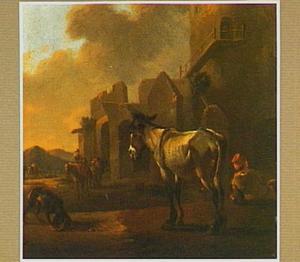 Een ezel voor een ruïne in een zuidelijk landschap