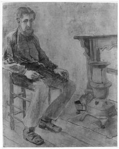 Man zittend bij een kachel