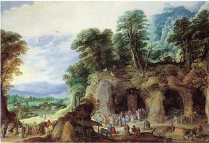 Landschap met een grot van een heremiet, waar een processie uitkomt
