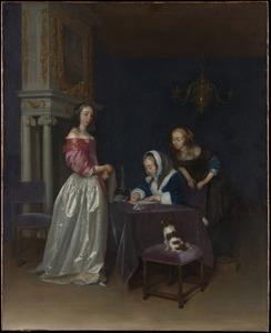 Drie jonge vrouwen rond een tafel in een interieur
