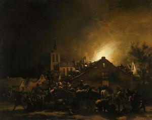 Brand in een dorp bij nacht