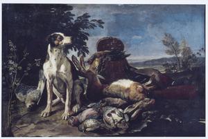 Een hond bij jachtbuit in een landschap