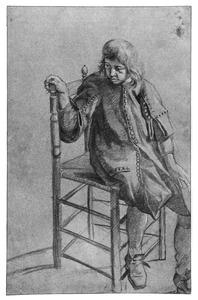 Jonge man zittend op een stoel