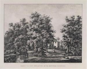 Doorkijk naar de hofstede Elsbroek tussen de bomen