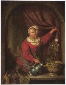 Een jonge vrouw begiet een roos in een venster
