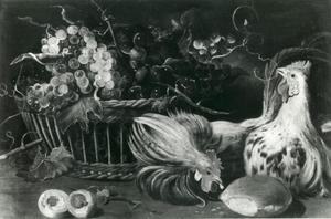 Een stillleven met fruit en levend gevogelte op een tafel