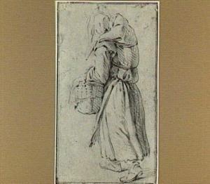 Lopende boerenvrouw met mand